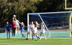 Center defender senior Isabelle de Wood goes up for a header to clear out the Panthers' corner kick.