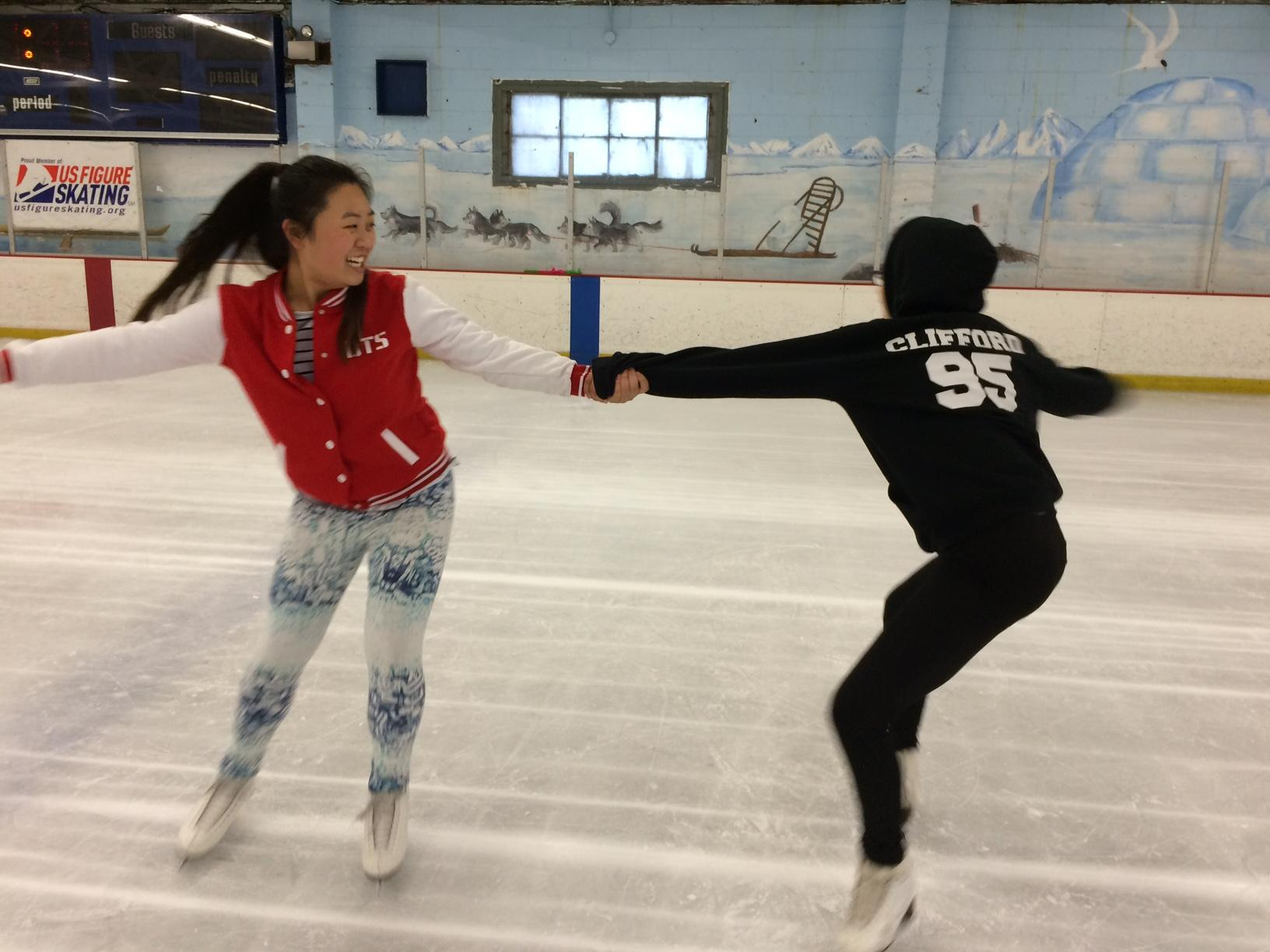 Freestyle 5 skaters and friends Leanne Luu (left) and Raven Myles (right) grip each other's hands and pull into a two-person spin. Myles said,