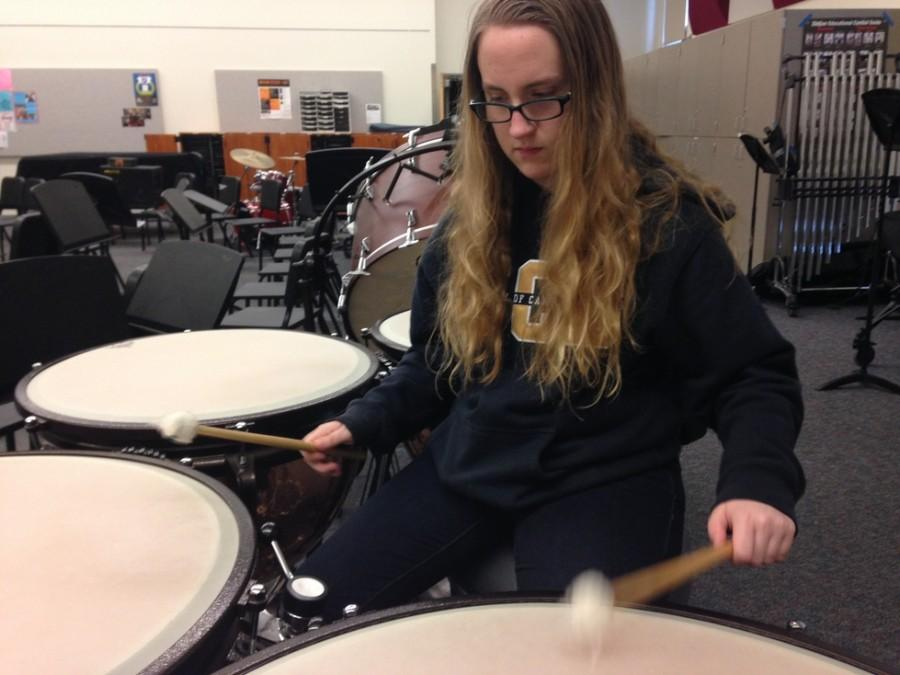 Sophomore Jenna Williamson practices the timpani during lunch. Williamson said,