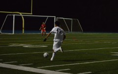 Sophomore Matthew Mathias (45) races down the field in effort to score a goal.