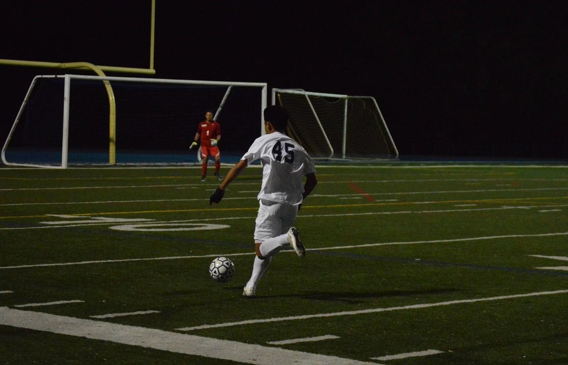 Sophomore Matthew Mathias (45) races down the field in effort to score a goal.