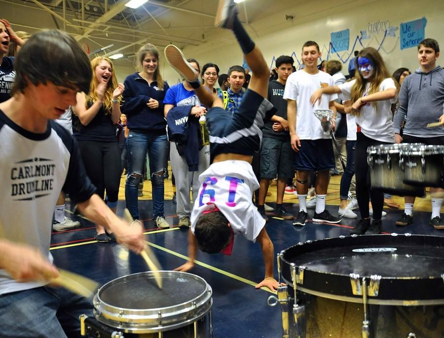 Freshman Kyle Dimick steals the crowd by breakdancing to a drum sequence at the end of the game.