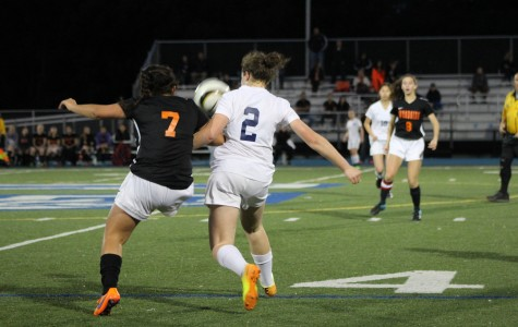 Isabel Mayoss challenges the ball as she plays with intensity against the Wildcats.