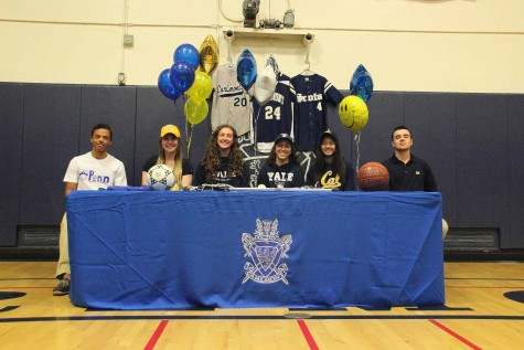 The six commits of 2016 proudly wear their college apparel as they celebrate with friends and family their official commitments to colleges.