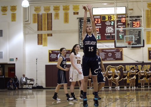 Varsity shooting guard and freshman Ashley Trierweiler shoots two free throws for the Scots.
