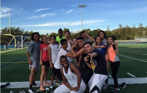 A group of the 2016 varsity and JV track runners pose for a photo after practice, full of energy and ready for the season to begin.