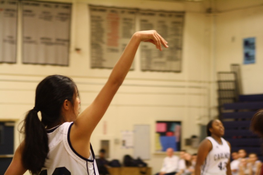 Freshman Jayla Chee shoots a mid-range jumper for the Scots.