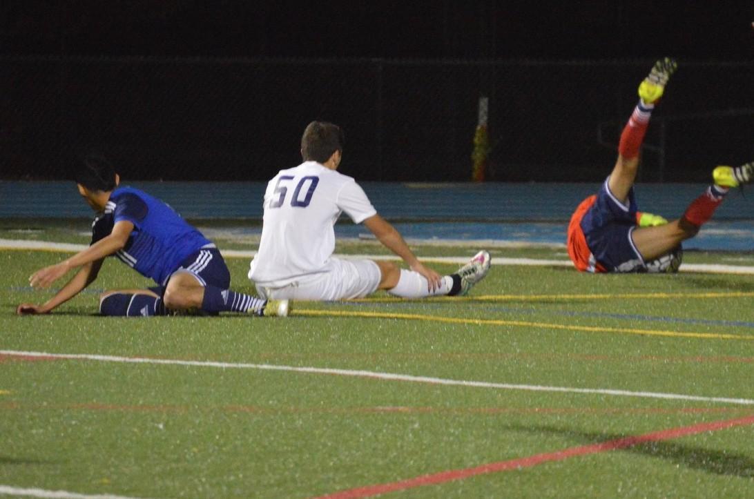 The Alvarez keeper clutches the ball after sophomore Noah Sanchez makes an attempt on goal.