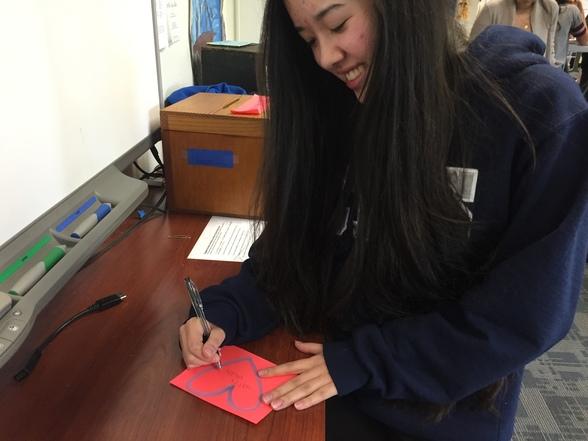 Sophomore Katie Fetterman writes a valentine to her friend.