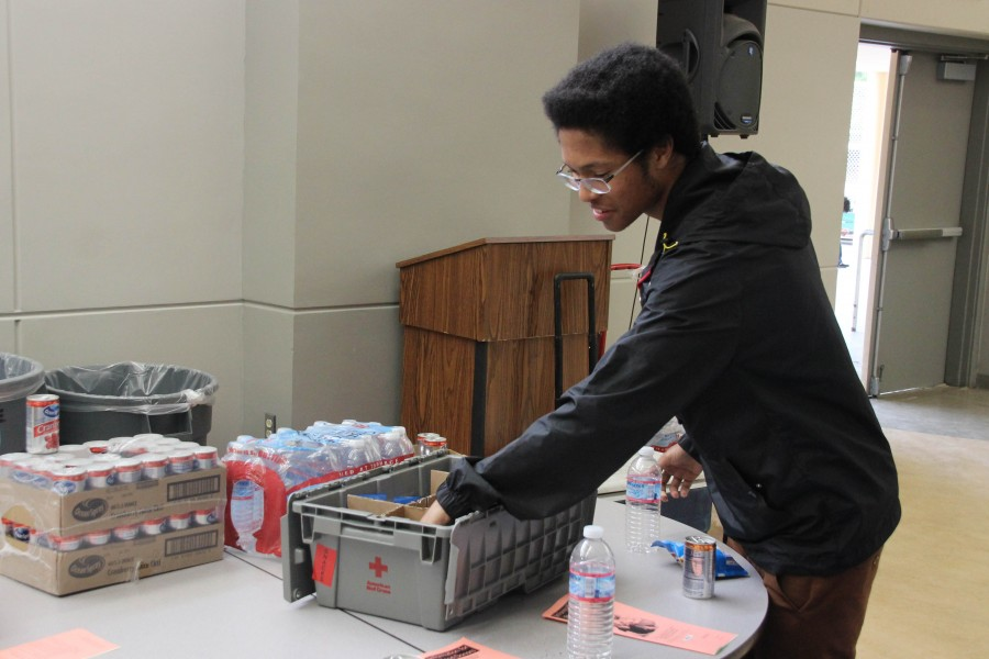 The American Red Cross provides snacks and water for the donors.  Sophomore Zade Vela grabs a snack after donating blood for the first time.
