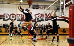 Team captain and junior Chris Ding prepares to spike the ball.
