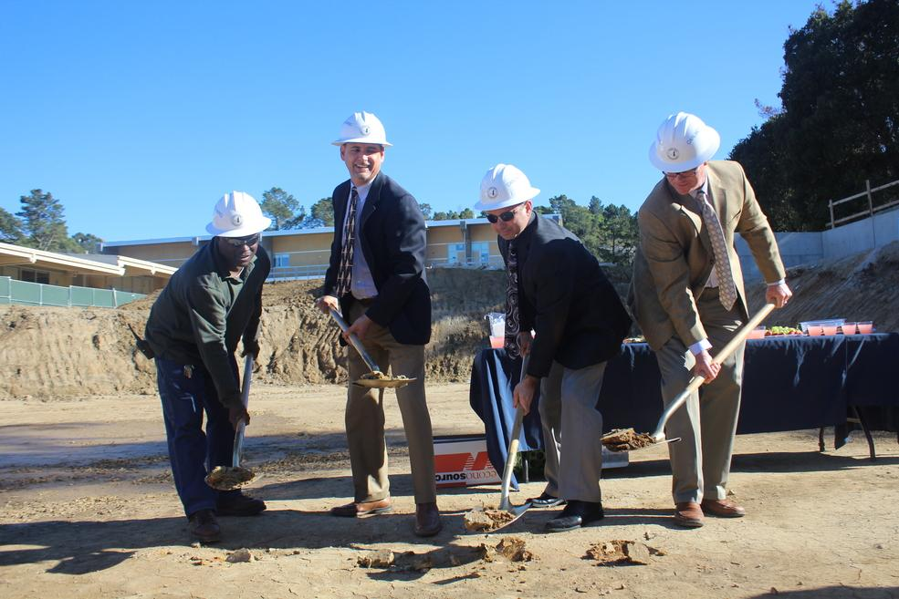 Plant Manager Jerome Harris, architech Carrick Boshart, Principal Ralph Crame, and Vice Principal Grant Steunenberg use the ceremonial groundbreaking shovels to dig into the ground where the Carlmont