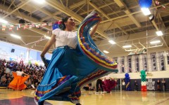 Senior Kathleeyn Moreya also performs with Latinos Unidos. The dance, Zapateado, is about el Toro, a boy, finding the girl in the red skirt because Toros are attracted to red. Throughout the whole dance, the boy dances with all the girls until he finds the specific girl with the red skirt.