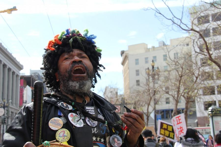 At San Francisco's Market St., this man leads protesters in chants such as