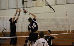 Senior Malcolm McClellan (18) spikes the ball, earning a point for the Scots.