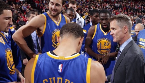 Head Coach Steve Kerr of the Golden State Warriors talks strategy with the players.