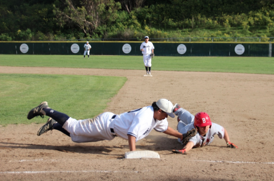 Sophomore Jordan Brandenburg puts the tag down on a pickoff move from junior Matt Reiley.
