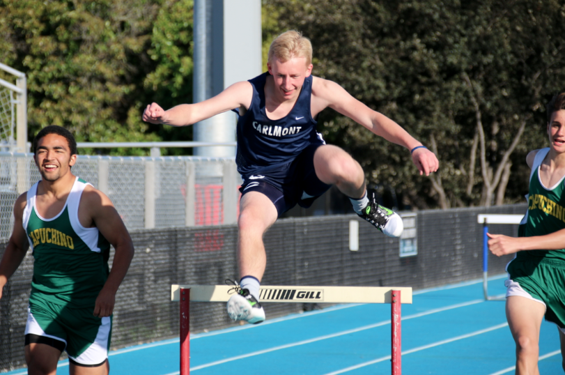 Senior Steven Palthe clears the hurdle in the boys' 110-meter hurdle race.