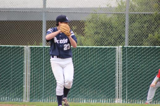 Senior Spencer Stewart goes through his pitching motion, trying to get the batter out.