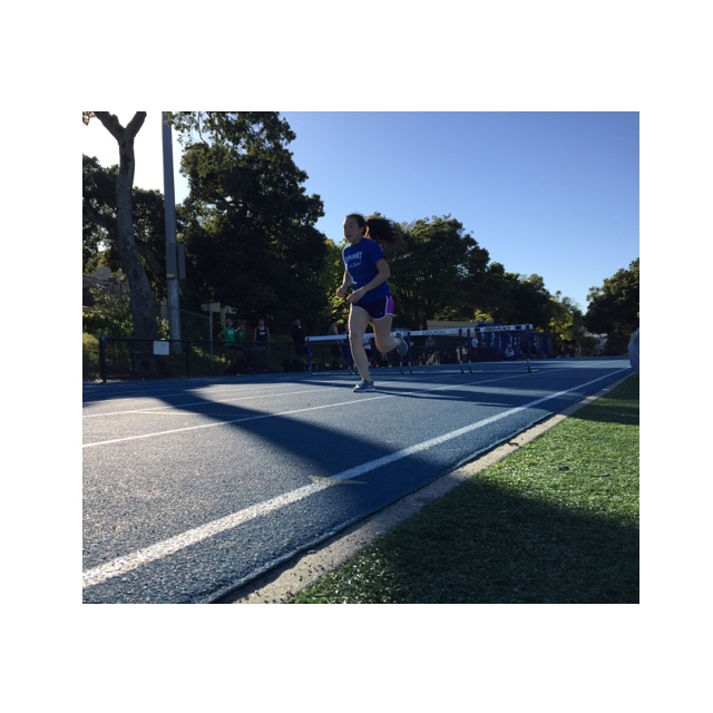 Sophomore Dana Yang runs on the Carlmont track during practice as the team prepares for the meet against Woodside.