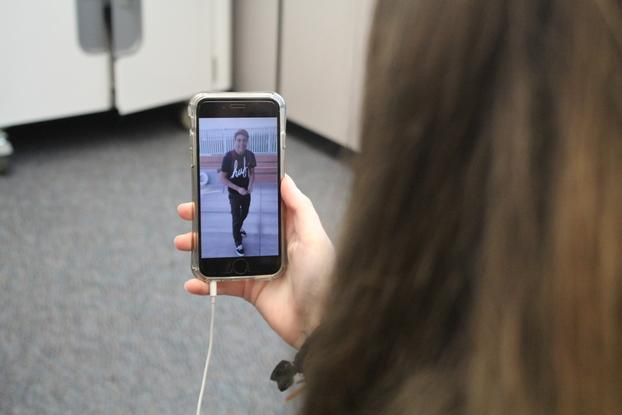 A Carlmont student watches the famous video of Daniel in his white Vans.