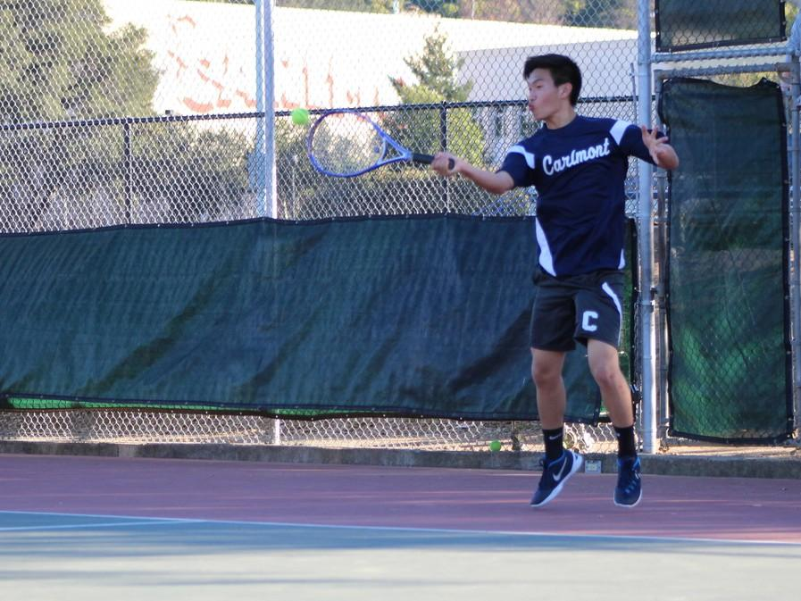 Sophomore Kevin Xiang returns the opponent's serve, eventually winning the point.