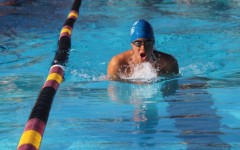 Junior Alejandro Aguirre swims his breaststroke event.