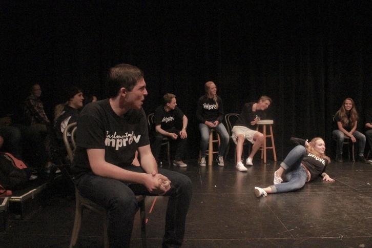 Junior Blake Du Bois acts as an interpreter during a game where the actors pretend to speak in a foreign language.