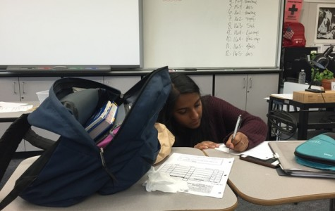 Student Rhea Subramanian rushes to finish her work as she settles back into the routine of school.