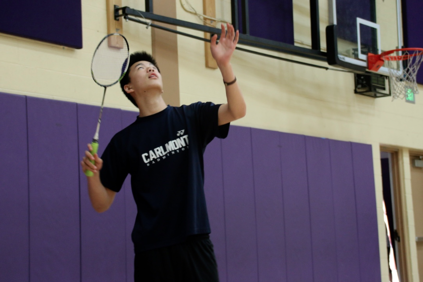 Senior Jeshurun Chen looks up and prepares to smash the shuttlecock to the other side.