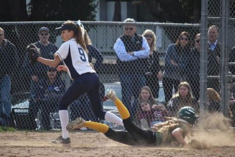 Kinsey Cook picks off a Capuchino player for a double play.