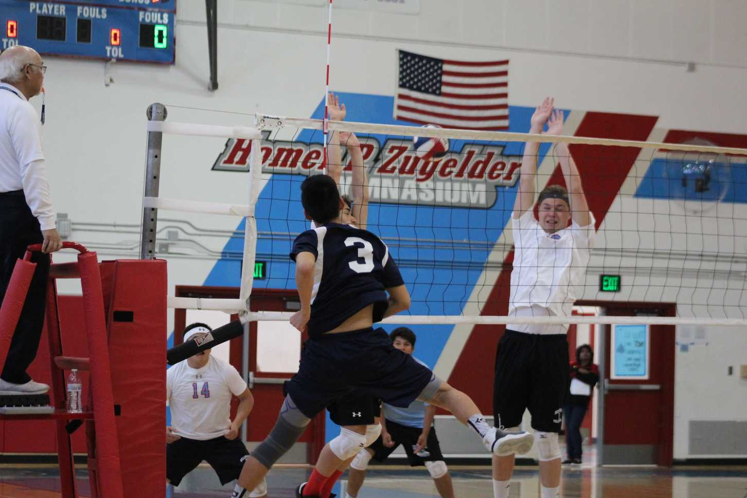 Junior Chris Ding smashes the ball over the net, earning a point for the Scots.
