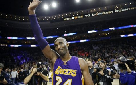 Los Angeles Lakers' Kobe Bryant waves to the crowd after an NBA basketball game against the Philadelphia 76ers on Tuesday, Dec. 1, 2015, in Philadelphia. Philadelphia won that game 103-91.