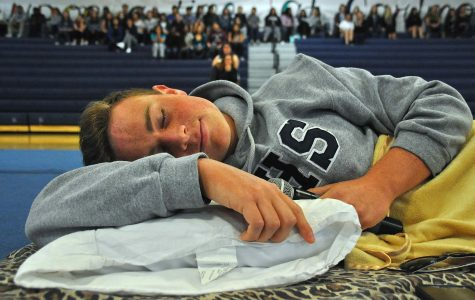 ASB President and senior Timmy Miller gets into position for the assembly's starting act.