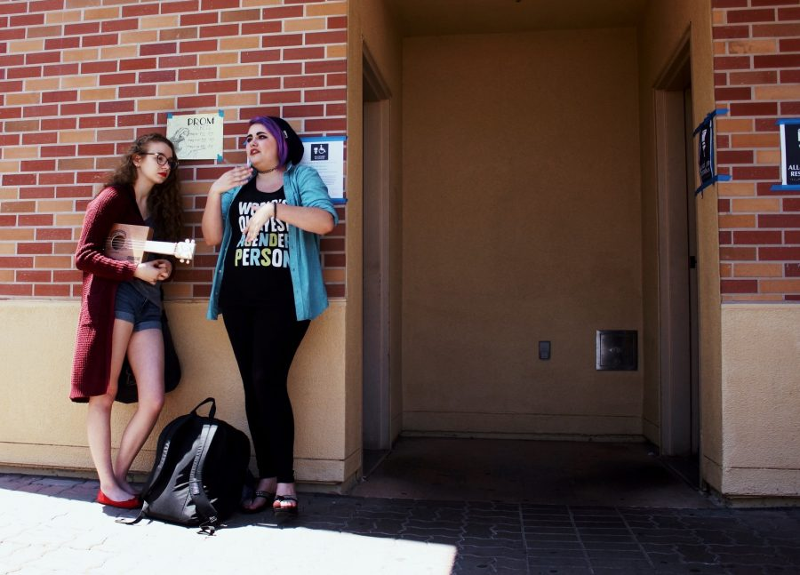 Senior Stephanie Revenelle and junior Alyssa Fiegelson stand otuside the gender neutral bathrooms.