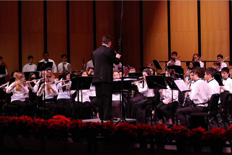 Carlmont+concert+band+performs+at+the+annual+winter+concert.+There+are+three+nights+of+concerts+every+winter+and+spring+featuring+Concert+Band%2C+String+Orchestra%2C+Symphonic+Band%2C+Symphony+Orchestra%2C+Jazz+Ensemble%2C+Morning+Jazz+Band%2C+and+several+jazz+combos.