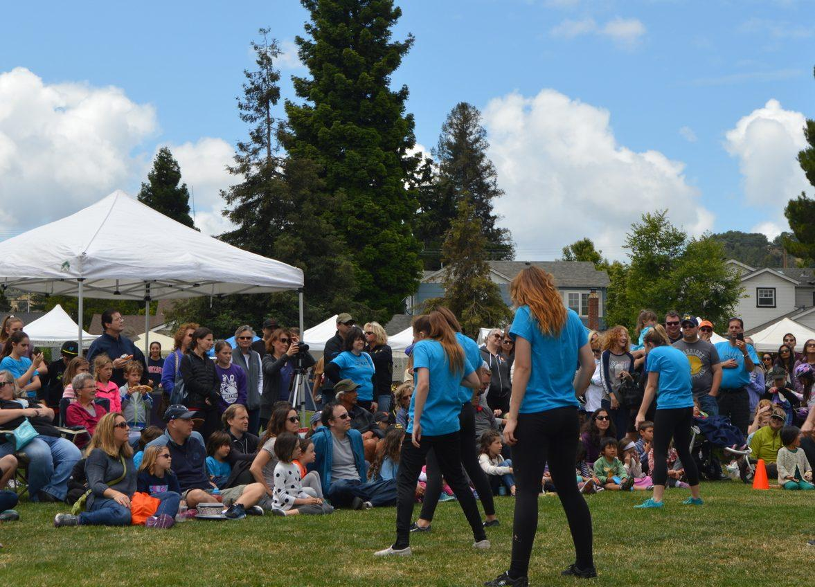 A crowd watches a local dance group perform on Saturday afternoon.