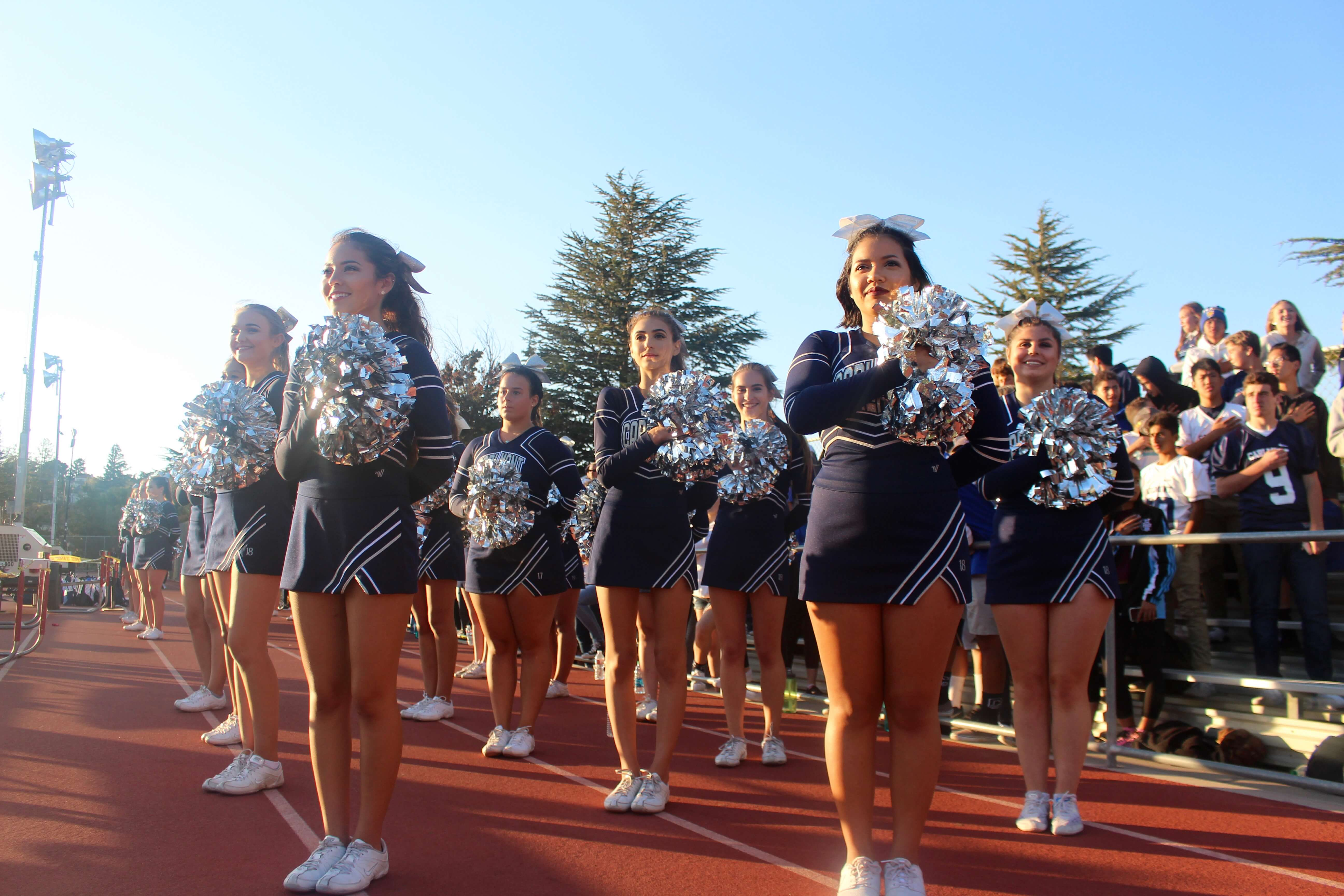 Carlmont+Cheer+stands+for++the+national+anthem+just+before+kickoff.