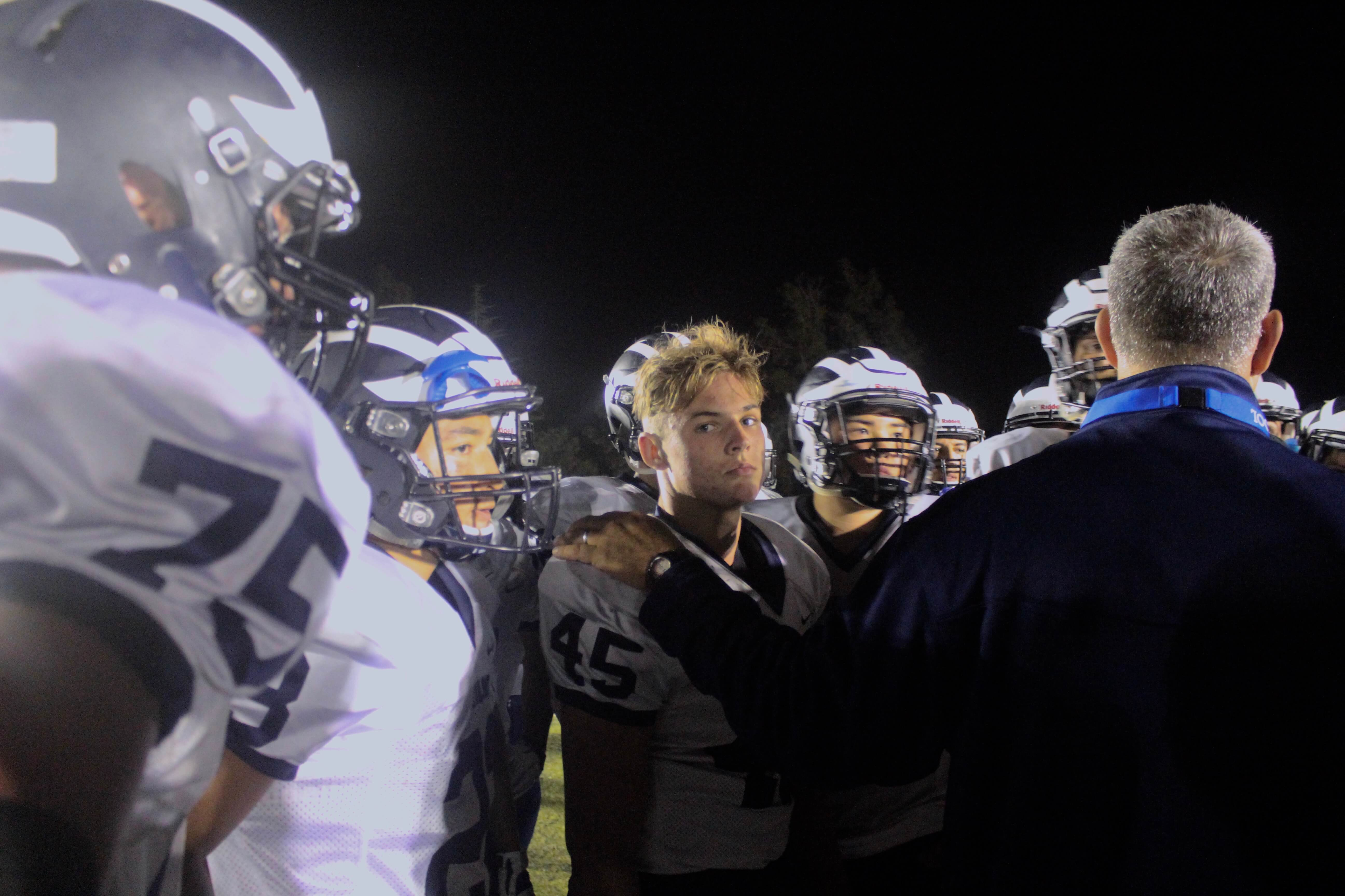 Coach+Jake+Messina%27s+hand+rests+Junior+Brett+O%27Connor%27s+shoulder+as+the+team+comes+in+a+huddle+after+the+game+concluded.