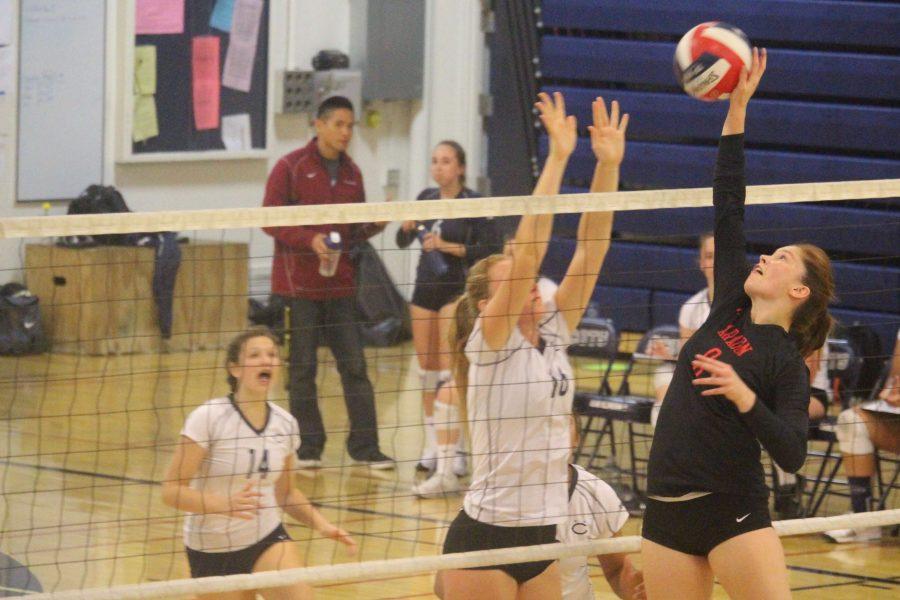 Aragon sophomore Della Trimble attempts to hit the ball as junior Emma Vanoncini jumps to block.