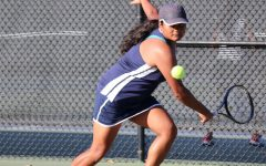 Senior Snehal Pandey sets herself up for a backhand return to gain the lead during her first set.