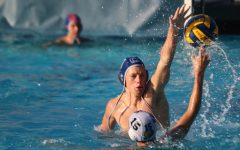 Senior Hunter Manter leaps out of the water to block his opponent from taking a shot.