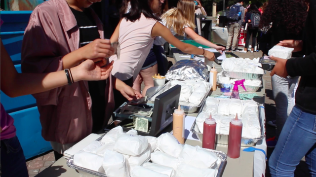 Students sell food to promote their clubs.