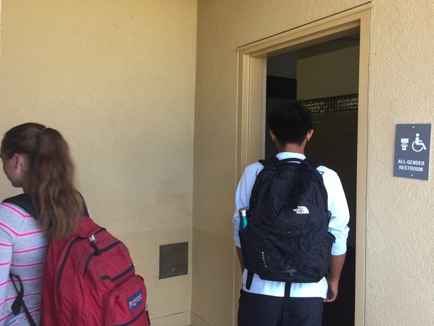 During lunch, juniors Matt Matias and Isabelle Boynton instinctively enter the previously assigned restrooms of their gender in the now all-gender restrooms.