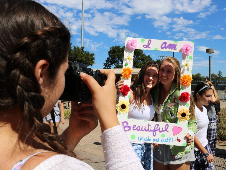 Sophomore Kayla Gustafson and senior Alyssa Fine pose for a photograph to celebrate Kind Week.