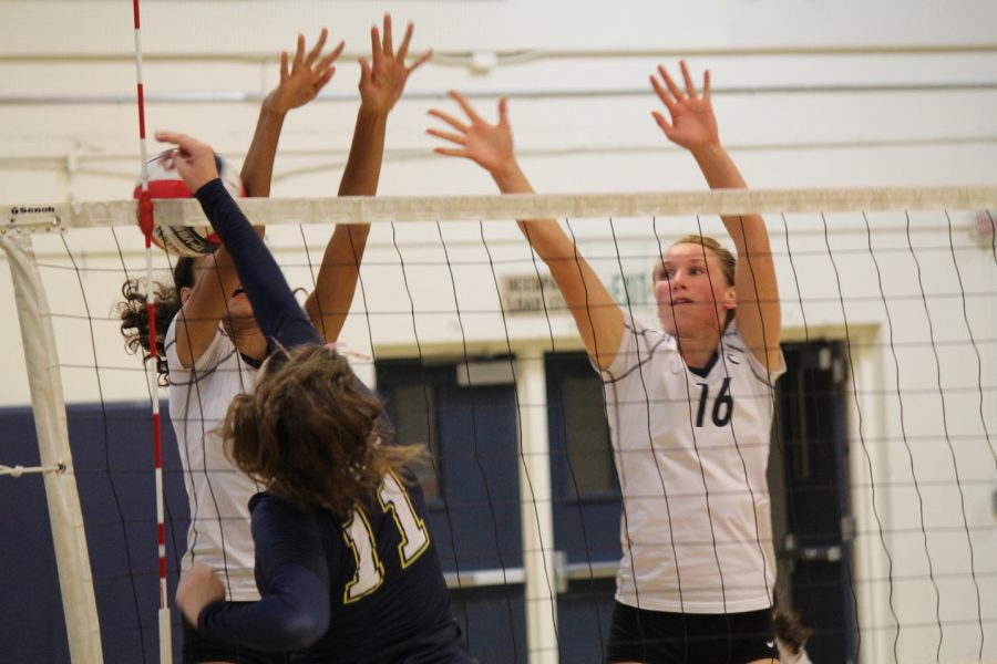 Juniors Sophie Srivastava and Emma Vanoncini block the Tigers' strong hit.