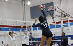 Junior Maya McCllean spikes the ball over the net earning  a point for the Scots.