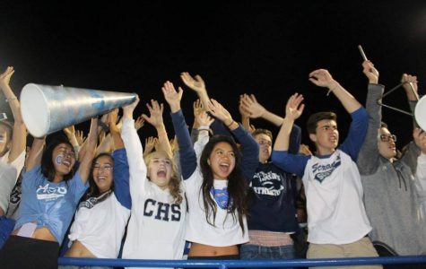 Students in Screamin' Scots show off their Carlmont logos at a home football game.