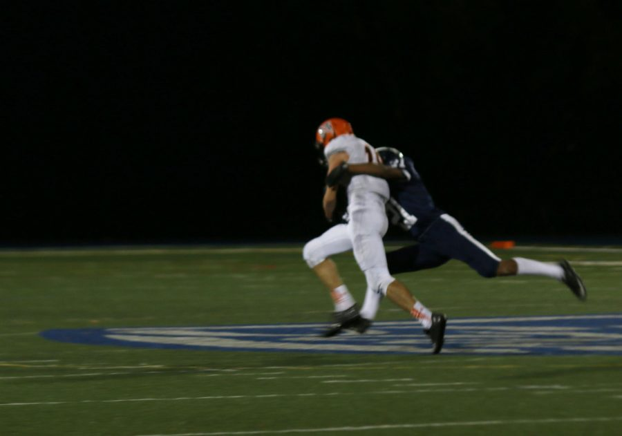Bryan Tara tackles his San Mateo opponent to the ground, shutting down a scoring opportunity for the Bearcats.