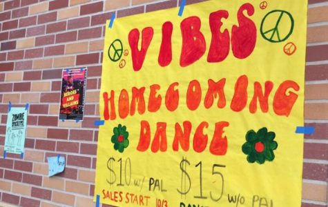ASB puts up posters advertising the homecoming dance, which will take place on Oct. 15.